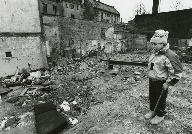A young boy plays in the rubble of a demolished housing project in Connewitz. Restricted to personal, non-commercial use only. For permission to publish, contact Special Collections & Archives,  George Mason University Libraries, speccoll@gmu.edu.