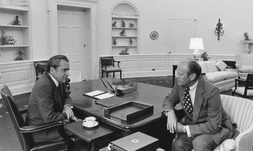 Nixon and Ford talking in the Oval Office before Nixon announced his resignation, effective at noon the following day (August 8, 1974). Oliver F. Atkins photograph collection, Box 48, Folder 1. George Mason University. Libraries. Special Collections & Archives. Copyright not held by George Mason University Libraries. Restricted to personal, non-commercial use only. For permission to publish, contact Special Collections and Archives.