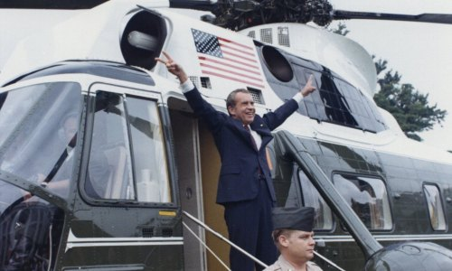 Nixon gives a final victory sign before he boards Marine One (August 9, 1974). Oliver F. Atkins photograph collection, Box 26, Folder 1. George Mason University. Libraries. Special Collections & Archives. Copyright not held by George Mason University Libraries. Restricted to personal, non-commercial use only. For permission to publish, contact Special Collections and Archives.