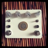 Custom Pedal 54, combining an Interfax Harmonic Percolator with a Gold Standard.