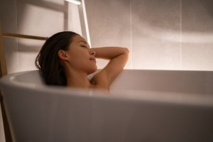 woman taking a bath relaxing