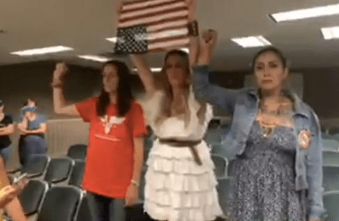 An upside down American flag to protest a law to get kids vaccinated and protected?