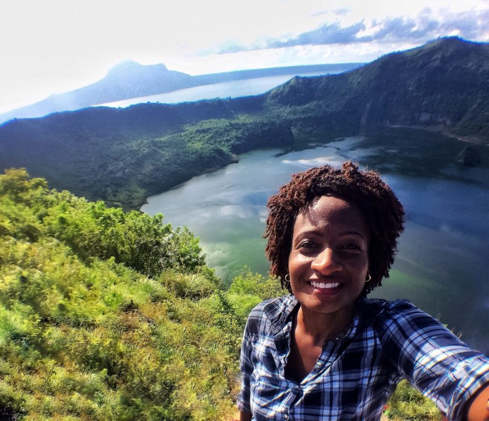 Black travel blogger at Taal Crater Lake, Philippines https://vaycarious.com