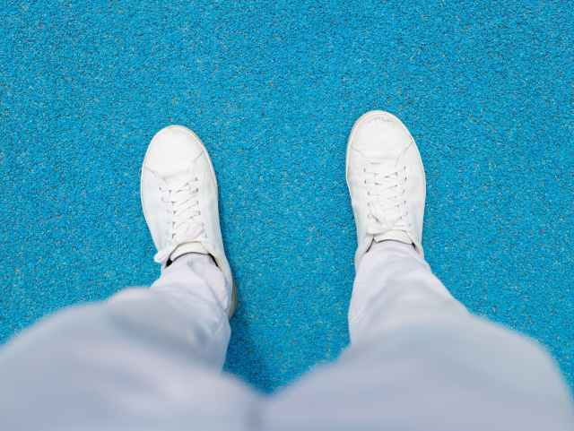 person wearing white sneakers