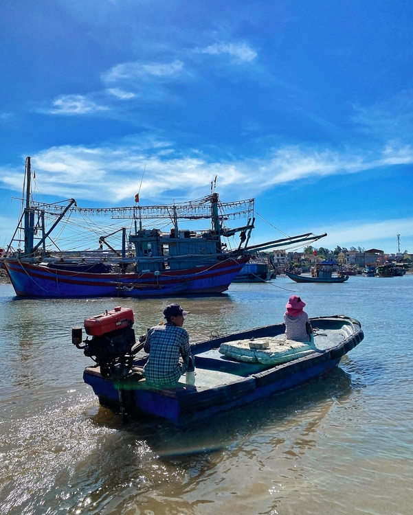 Locals travel on boat in Nghi Son peninsula.