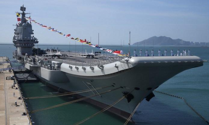 Tàu sân bay Sơn Đông trong lễ biên chế hôm 17/12. Ảnh: Bộ Quốc phòng Trung Quốc.