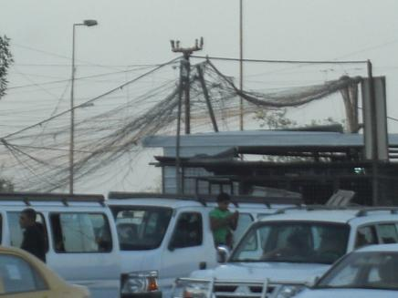 Above this gridlock you can also see the web of electrical wires.