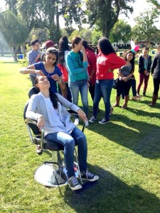 Owner Panna Karia participates in a local event, threading eyebrows for unwanted hair.