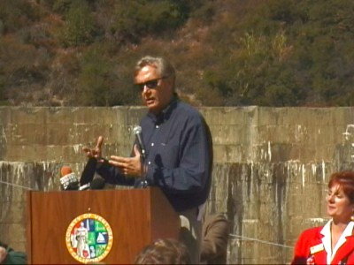Secretary of the Interior Bruce Babbitt speaks to a crowd of environmentalists and Ventura County politicians in front of the Matilija Dam in October in the year 2000.