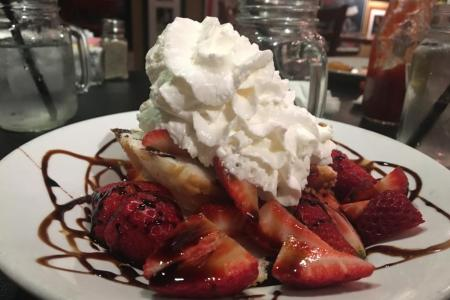 Strawberry shortcake — truly an indulgence, but well worth the calories. Loaded with the ripest local (of course) strawberries, drizzled with chocolate and heaped with whipped cream.
