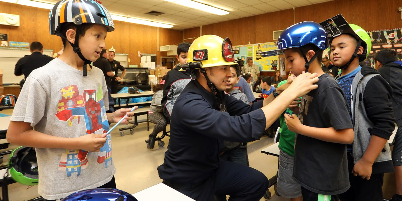 KINDNESS CORNER | Hats off to Firefighters providing helmets to cyclists