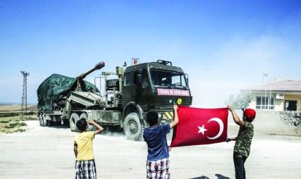 HATAY, TURKEY - SEPTEMBER 10: Kids greet Turkish military convoy