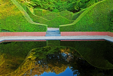Reflecting Pool Veddw House Garden, Monmouthshire, Wales. Designed and created by Anne Wareham and Charles Hawes. July. The Reflecting Pool and Hedge Garden with view to the Coppice. Yew Hedges (Taxus baccata)