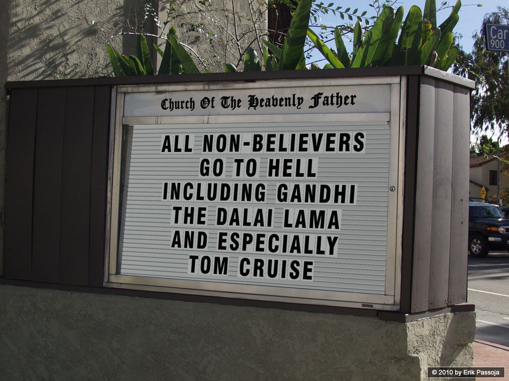 "Photo of a real sign in front of a church that says, ""All non-believers go to Hell including Gandhi, the Dali Lama, and especially Tom Cruise."""