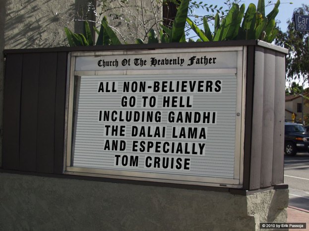 """Photo of a real sign in front of a church that says, """"All non-believers go to Hell including Gandhi, the Dali Lama, and especially Tom Cruise."""""""