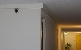 Bewakingscamera's plaatsen flatgebouw Amsterdm