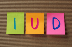 IUD spelled out on post it notes