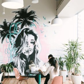 """Creative WeWork office space with mural and palm trees"""" title=""""we-work-instagram-7.png"""" caption=""""false"""" srcset=""""https://cdn2.hubspot.net/hub/53/hubfs/we-work-instagram-7.png?t=1527221885826&width=146&name=we-work-instagram-7.png 146w, https://cdn2.hubspot.net/hub/53/hubfs/we-work-instagram-7.png?t=1527221885826&width=292&name=we-work-instagram-7.png 292w, https://cdn2.hubspot.net/hub/53/hubfs/we-work-instagram-7.png?t=1527221885826&width=438&name=we-work-instagram-7.png 438w, https://cdn2.hubspot.net/hub/53/hubfs/we-work-instagram-7.png?t=1527221885826&width=584&name=we-work-instagram-7.png 584w, https://cdn2.hubspot.net/hub/53/hubfs/we-work-instagram-7.png?t=1527221885826&width=730&name=we-work-instagram-7.png 730w, https://cdn2.hubspot.net/hub/53/hubfs/we-work-instagram-7.png?t=1527221885826&width=876 &name=we-work-instagram-7.png 876w"""" sizes=""""(max-width: 292px) 100vw, 292px"""