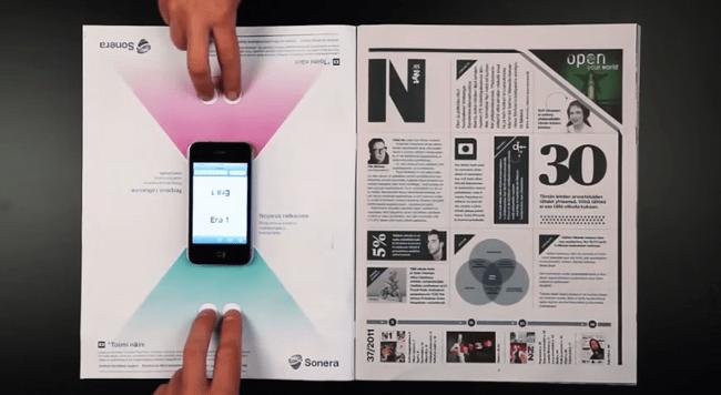 Anuncio impreso interactivo de Sonera con juego de mesa para teléfonos inteligentes