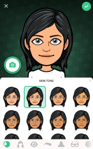 Pantalla de la aplicación Bitmoji con avatar de pelo negro y opciones de tono de piel