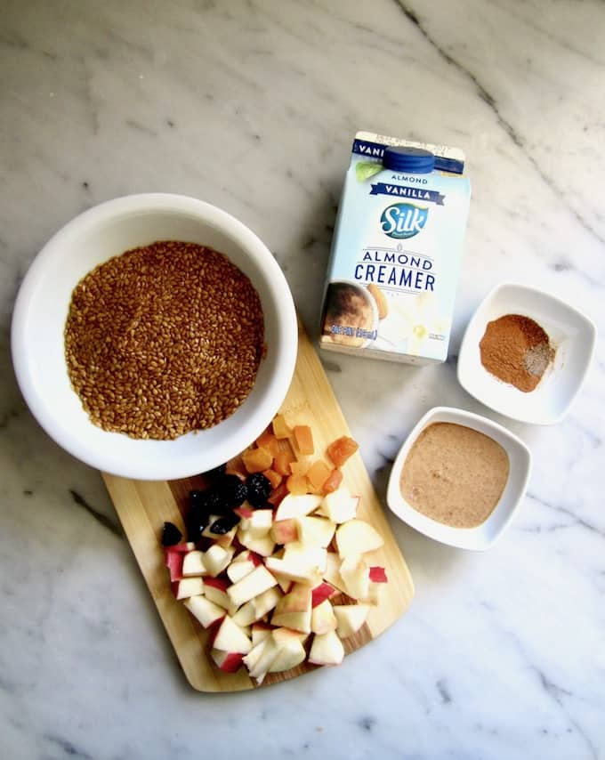 Warm 5 Minute Vanilla Flaxseed Cereal (Vegan + Gluten Free) - This warm, creamy porridge comes together in just 5 minutes. Substitute whatever fruit and dried fruit you want, making this a versatile recipe perfect for busy mornings! | veganchickpea.com #shop #ad #SilkandSimplyPureCreamers #cbias