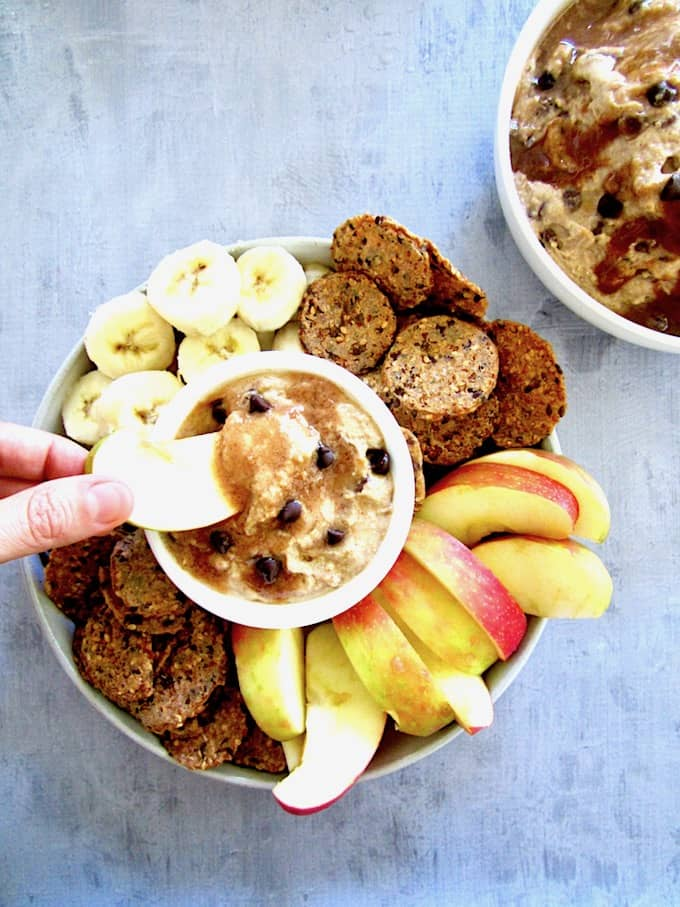 This chocolate chip dip dessert hummus is a sweet spread made from chickpeas and flavored with almond butter, maple syrup and mini chocolate chips - all topped with an easy caramel sauce. Filled with protein and fiber, this healthier dessert is also vegan, gluten free and refined sugar free!