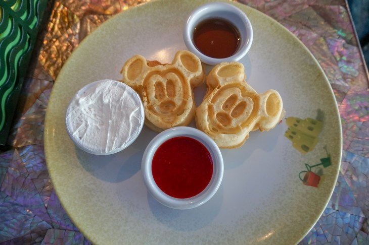 Vegan mickey waffles with vegan whipped cream, strawberry sauce and syrup
