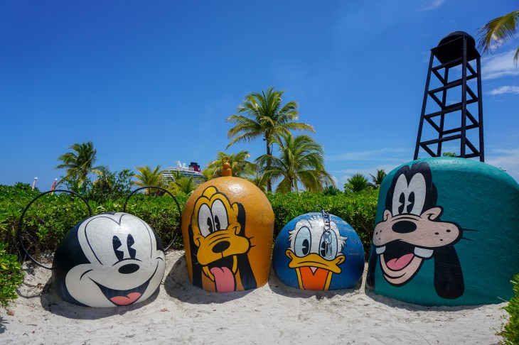 Characters in front of ship at Castaway Cay