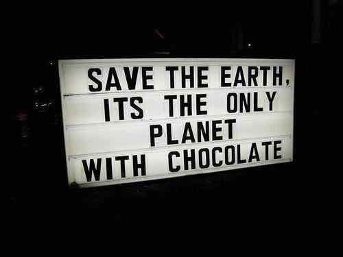 "Image of a sign that says ""Save the earth, it's the only planet with chocolate."""