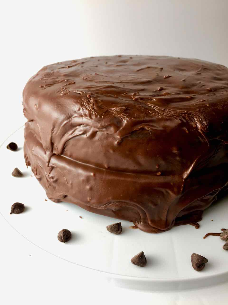 Image of whole foods plant based oil-free chocolate vegan layered birthday cake with vegan frosting