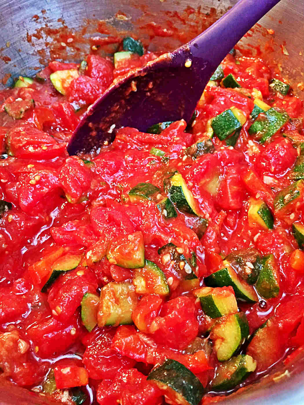 Image of canned diced tomatoes and zucchini in the large pot
