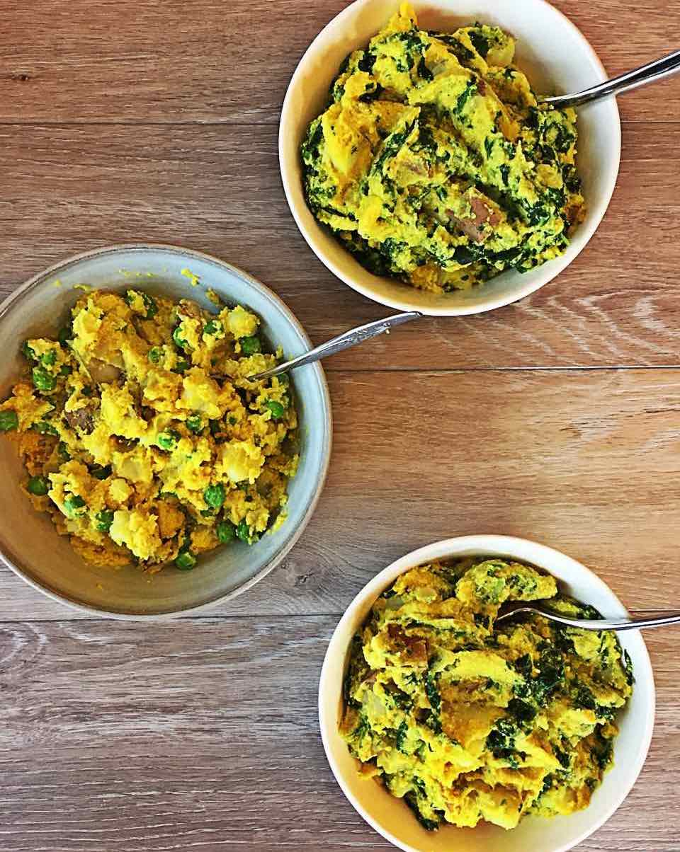 Image of lazy vegan frittata, some with peas and some with spinach, in bowls.