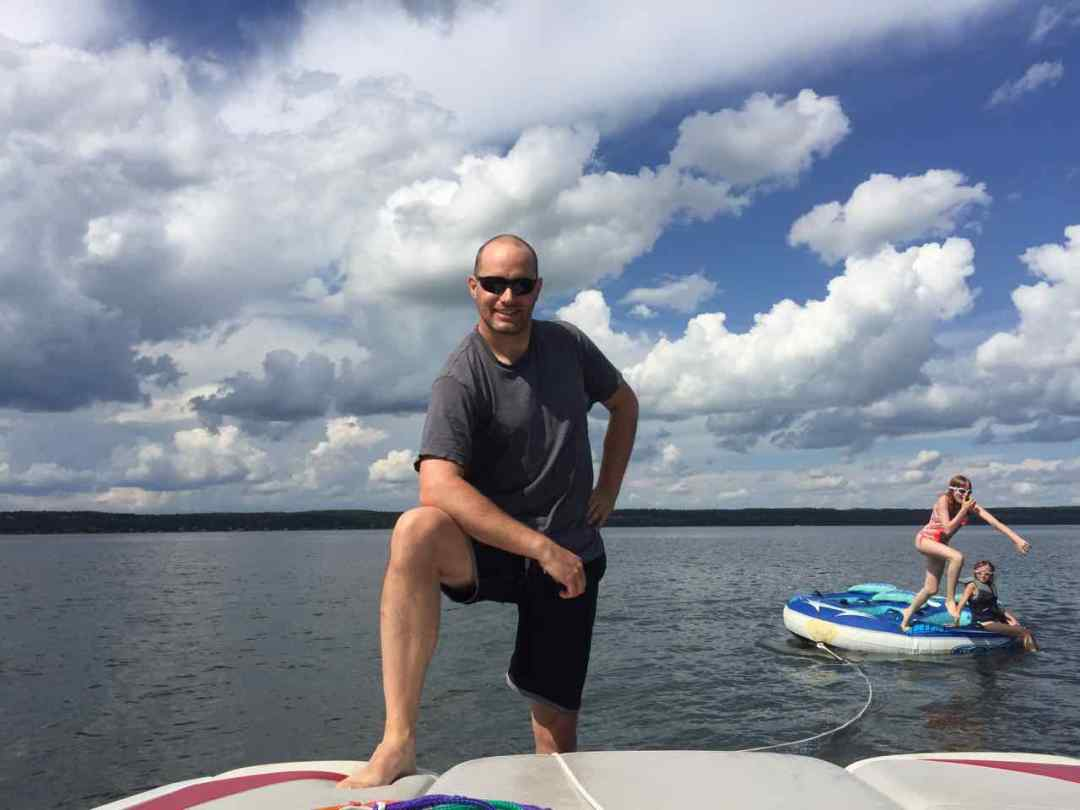 Image of an active vegan family at a lake.