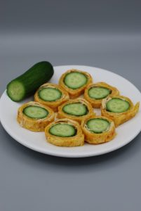 Wrapped cucumber sandwiches with hummus.