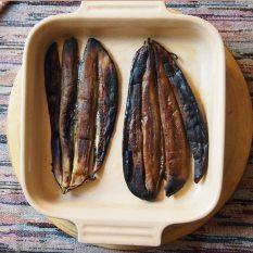 place aubergines in ceramic oven dish