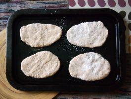 pitta dough, flattened and ready to bake
