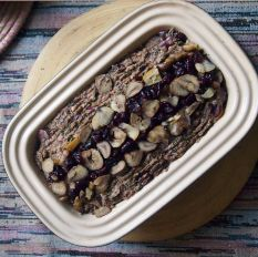decorate nut roast with sliced chestnuts and dried cranberries...and a tiny drizzle of oil