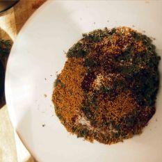 ground cumin, sumac and herbs