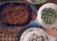 aubergine bake served with baby broad beans