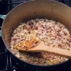 add 1 glass 120-130ml. dry white wine to sautéed rice +onion