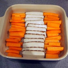 lay the sliced tofu and the carrot batons in a ceramic dish