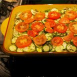 top with sliced tomatoes
