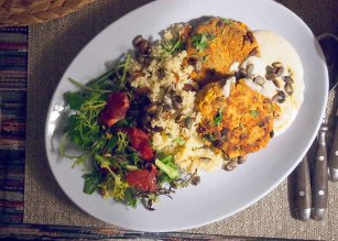 moroccan chickpea burgers with date and parsley cols-cous blood orange salad, harissa yogurt dip and toasted pumpkin seeds