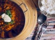 garnish curry with fresh coriander and coconut yogurt