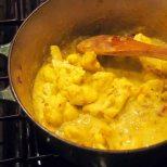 add cream sauce to sautéed cauliflower