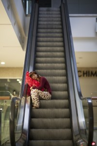 Woman sleeping on an escalator