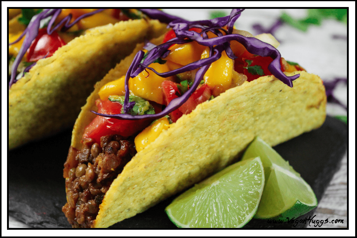 Side view of fully assembled taco on a slate board.