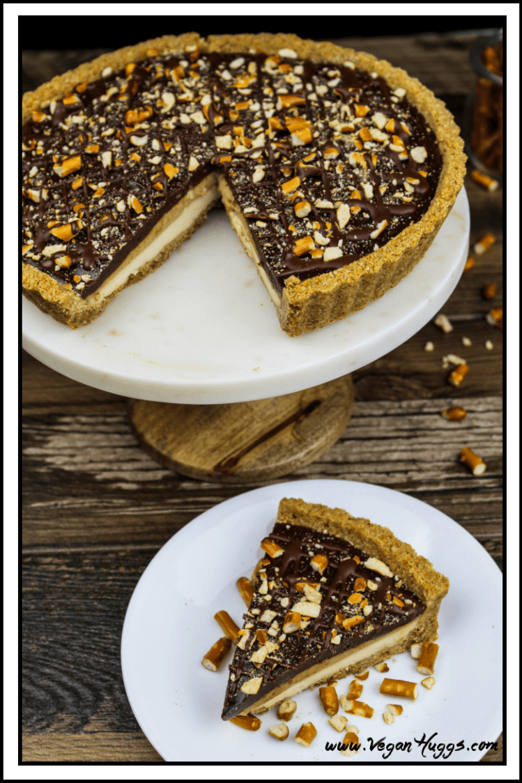 This Vegan Snickers Cream Pie has three dreamy layers that are nestled in a sweet & salty pretzel crust.
