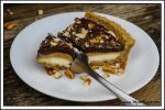 This Vegan Snickers Cream Pie has three dreamy layers that are nestled in a sweet & salty pretzel crust