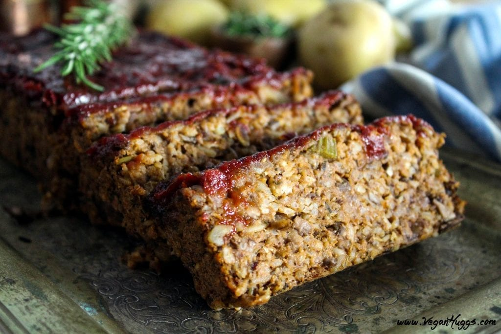 Side view of meatless loaf on a silver serving tray. Cut into slices